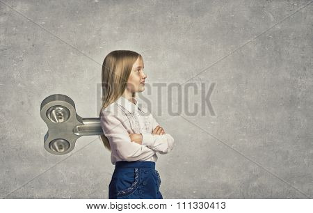 Little cute active girl with key on back