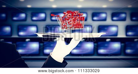 Hand with gloves holding a silver tray against televisions for sale