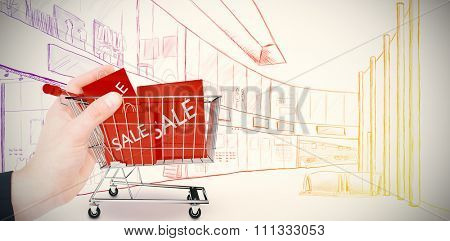 Businessman in suit holding his hand out against trolley with sale shopping bags