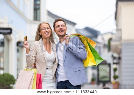 Attractive couple with shopping bags