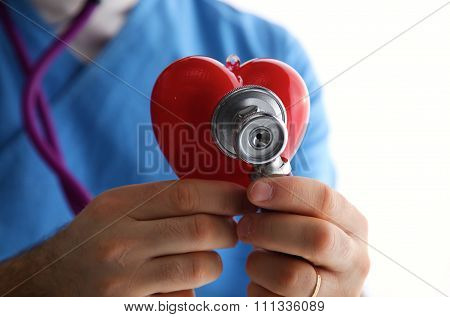 Doctor hand holding a stethoscope listening to heartbeat