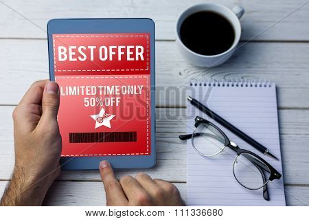 Sale advertisement against cropped image of person using tablet computer