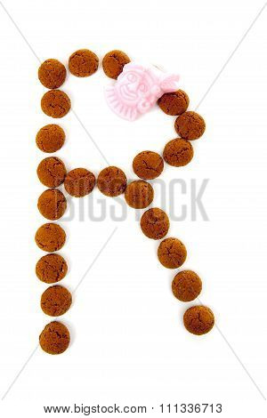 Ginger Nuts, Pepernoten, In The Shape Of Letter R Isolated On White Background