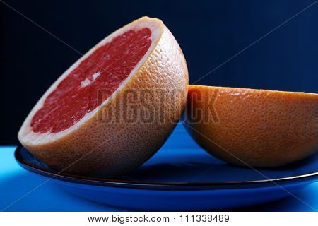 Grapefruit Halves Close-up On A Plate