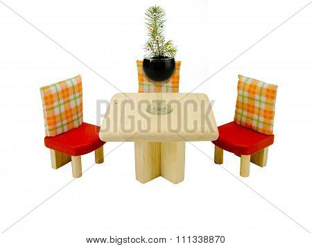 small elegant fir-tree in a shot glass on a table