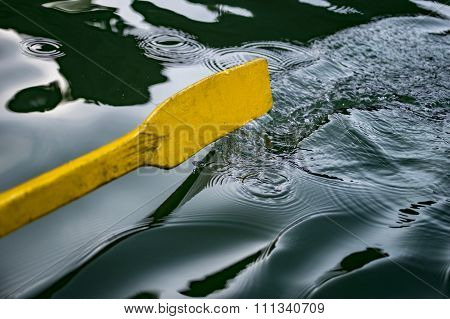 Oar Of Boat Touching Water