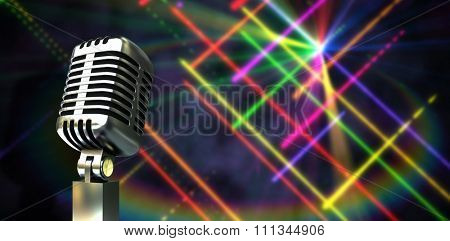 Digitally generated retro chrome microphone against digitally generated disco laser background