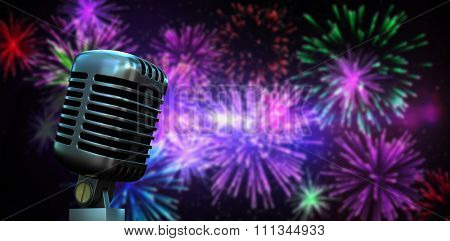 Digitally generated retro chrome microphone against digitally generated bright firework design