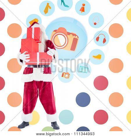Santa carrying gifts against colorful polka dot pattern