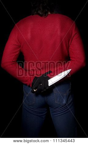 Man With Knife Behind Back