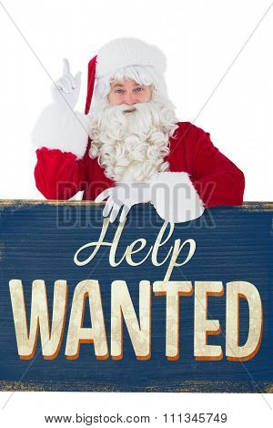 Smiling santa claus doing a gesture against vintage help wanted sign