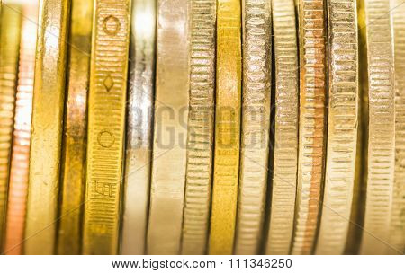 Selective Focus Golden Coins And Coins Stacked On Each Other In Different Positions,warm Toning