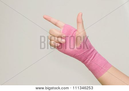 Young Woman With Pink Bandage Having Pain In Her Wrist
