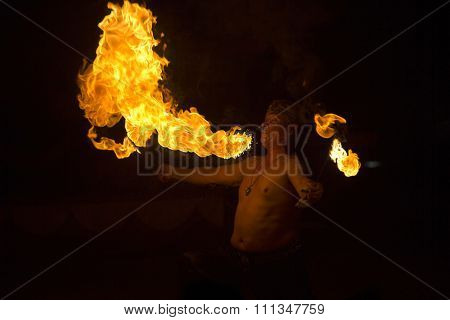 BRAGA, PORTUGAL - DECEMBER 13: Fire eater performing at Cardinali Circus on December 13, 2015 in Braga, Portugal.