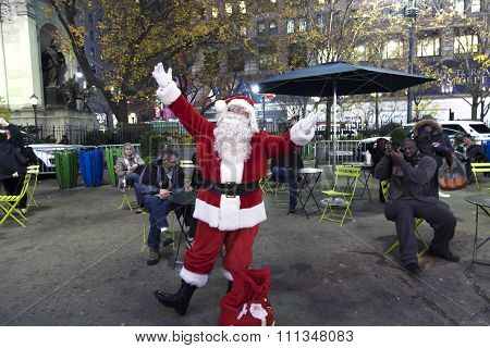 Santa Claus Poses Outside Of Herald Square Nyc