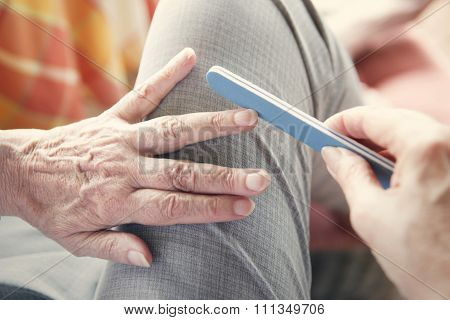 Closeup Of Woman's Hand With Nailfile