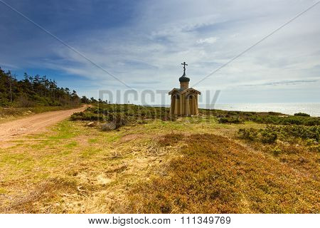 Wooden chapel by the sea.