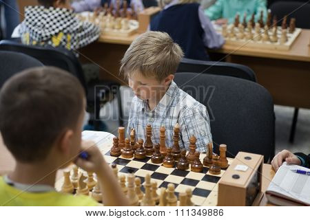 Little Clever Boy Thinking About Chess