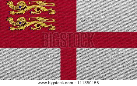 Flags Sark On Denim Texture.