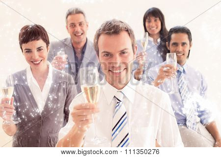 International business people toasting with Champagne against white fireworks exploding on black background