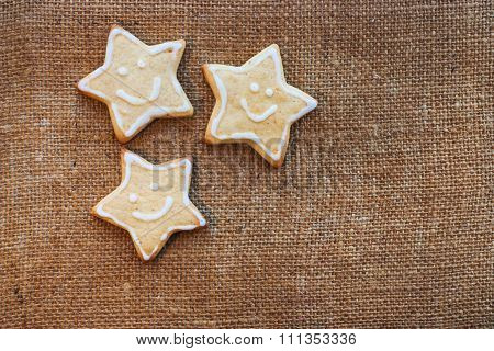 Three Christmas Cookies On The Flax Texture