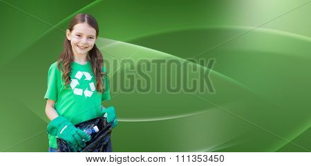 Happy little girl collecting rubbish against abstract green design