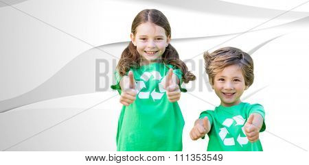 Happy siblings in green with thumbs up against white wave design
