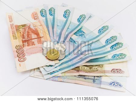 Russian money background. Ruble banknotes and coins of different denominations