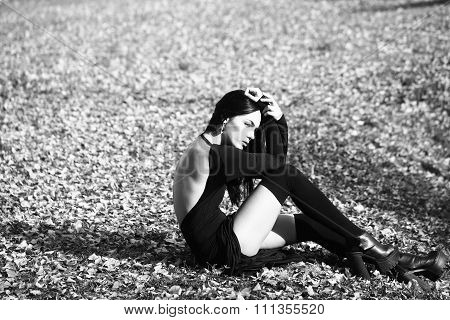 Pretty Woman Sitting Outdoors