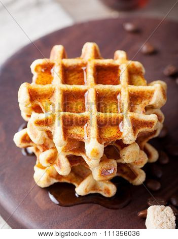 Whole wheat waffles with maple syrup and coffee