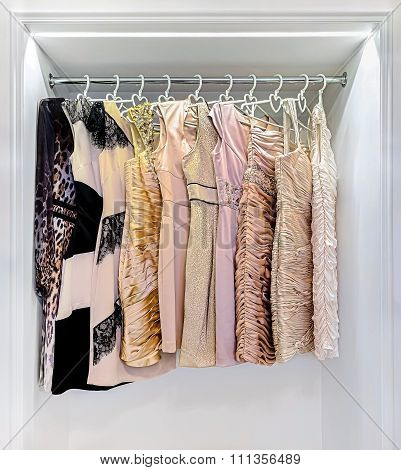 Row Of Colorful Dress In Wardrobe