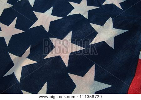Closeup Of Weathered Usa Flag In A Light Of Setting Sun