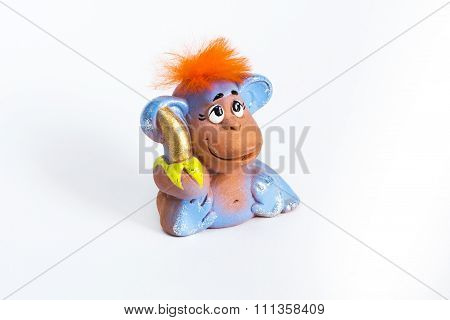 Red hair monkey with banana on white background