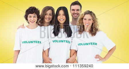 Group of people wearing volunteer tshirt against yellow vignette