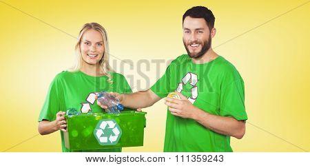 Portrait of happy man holding bottle against yellow vignette