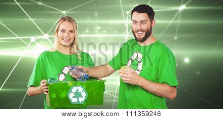 Portrait of happy man holding bottle against glowing geometric design