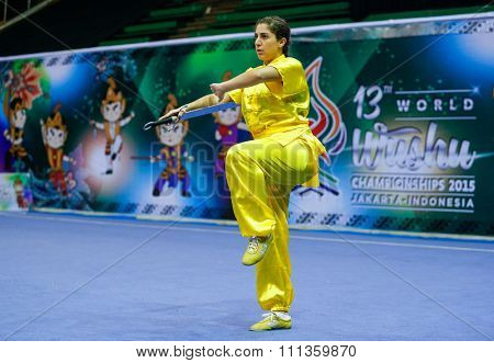JAKARTA, INDONESIA - NOVEMBER 17, 2015: Corryjane Aoun of Lebanon performs the movements in the women's Nandao event at the 13th World Wushu Championship 2015 held in the Istora Senayan Stadium.