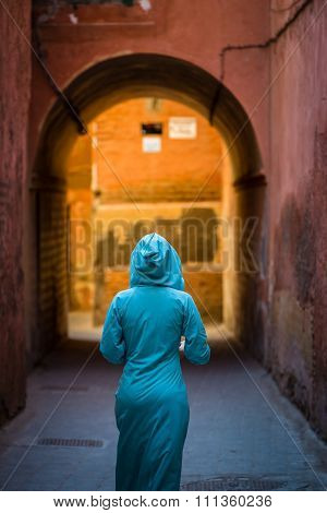 Traditionally Clothed Arabic Woman Walking In The Medina Of Marrakech