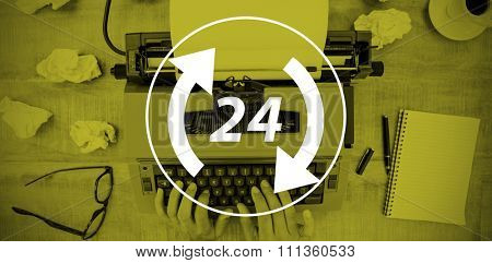 Twenty four and arrows against above view of old typewriter