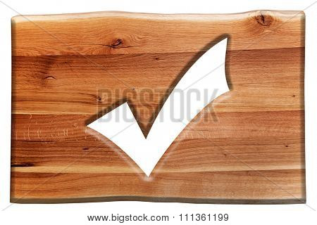 Tick, checking mark symbol cut in wooden board isolated on white. Natural oak wood