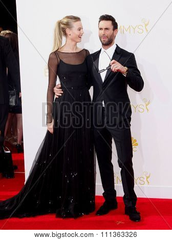 Behati Prinsloo and Adam Levine at the 66th Annual Primetime Emmy Awards held at the Nokia Theatre L.A. Live in Los Angeles on August 25, 2014.