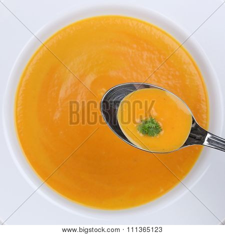 Healthy Eating Carrot Soup With Carrots On Spoon From Above