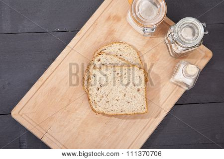 Gluten Free Bread On Plate With Spelled Flower On Black Wooden Background