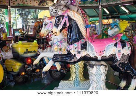 Rome, Italy - April 10, 2015 Nostalgic version of a traditional carousel with horses and other animals for fun of the children.