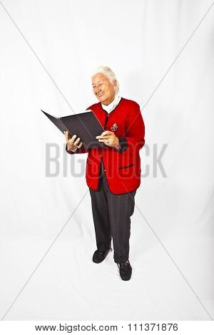 Smiling Attractive Elderly Woman Reading In A Book And Making A Speech
