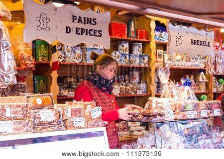 The Salesgirl On Christmas Market.