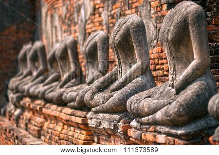 AYUTTHAYA,THAILAND-JANUARY 18,2015 : Ancient Buddha in  Wat Chaiwatthanaram. The temple was construction in 1630,name literally means of long reign and glorious era,in Ayutthaya Historical Park,Ayutthaya old capital city,Middle of Thailand.
