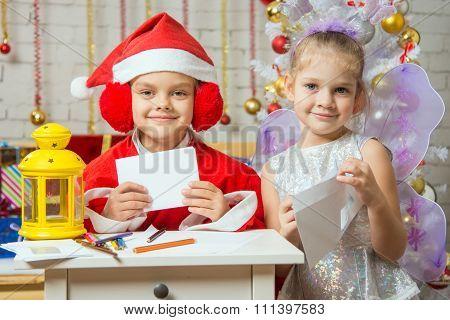 Makeshift Santa Claus And Fairy Prepare Congratulatory Letters