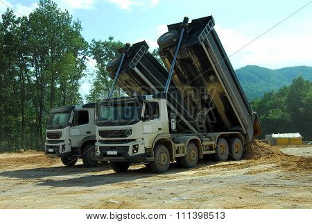 two truck tipper at work