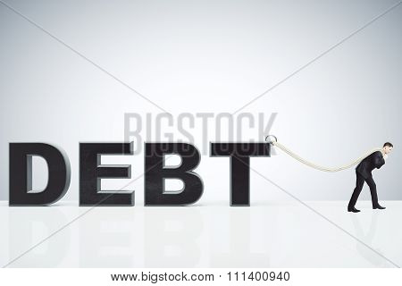Businessman Pulling A Rope The Debt Burden Concept
